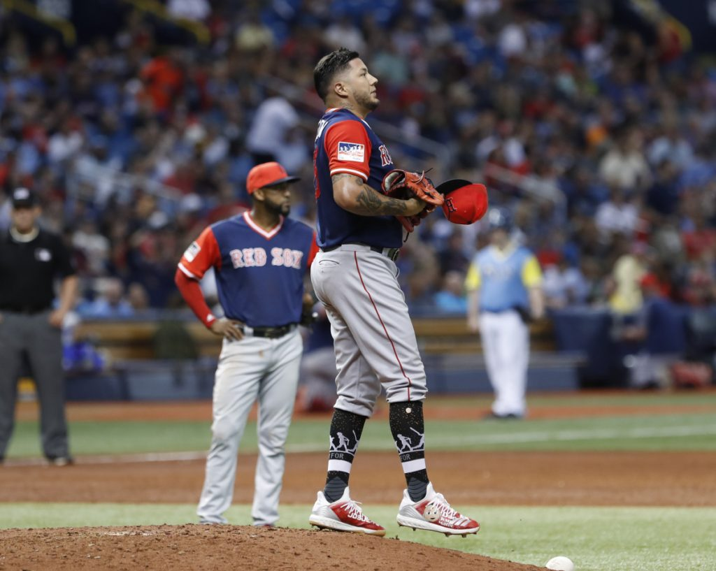 Red Sox starter Hector Velazquez stands on the mound after giving up a run during the third inning Friday night in St. Petersburg, Fla. The Rays scored 10 runs in the first four innings to win their sixth straight, 10-3.