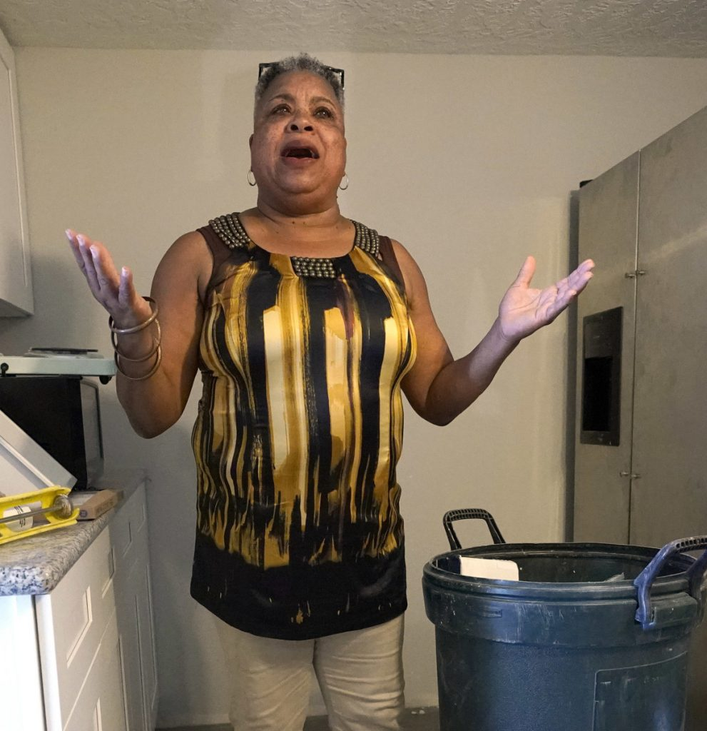 Shirley Paley talks about surviving Harvey earlier this month as she stands inside her Houston home. To the right, debris lines a road in Houston nearly a month after the hurricane passed through late last summer.