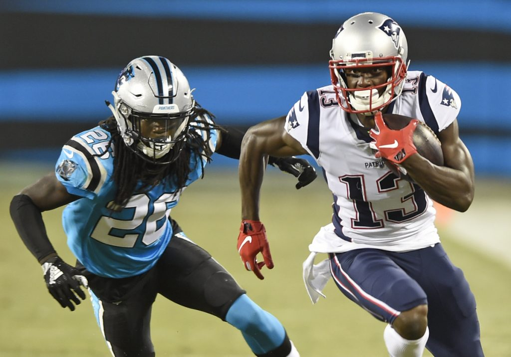 Patriots receiver Phillip Dorsett, right, runs past Carolina Panthers defender Donte Jackson during the first half of Friday's preseason game in Charlotte, N.C. Dorsett had four catches for 36 yards as he continues to earn Tom Brady's trust.