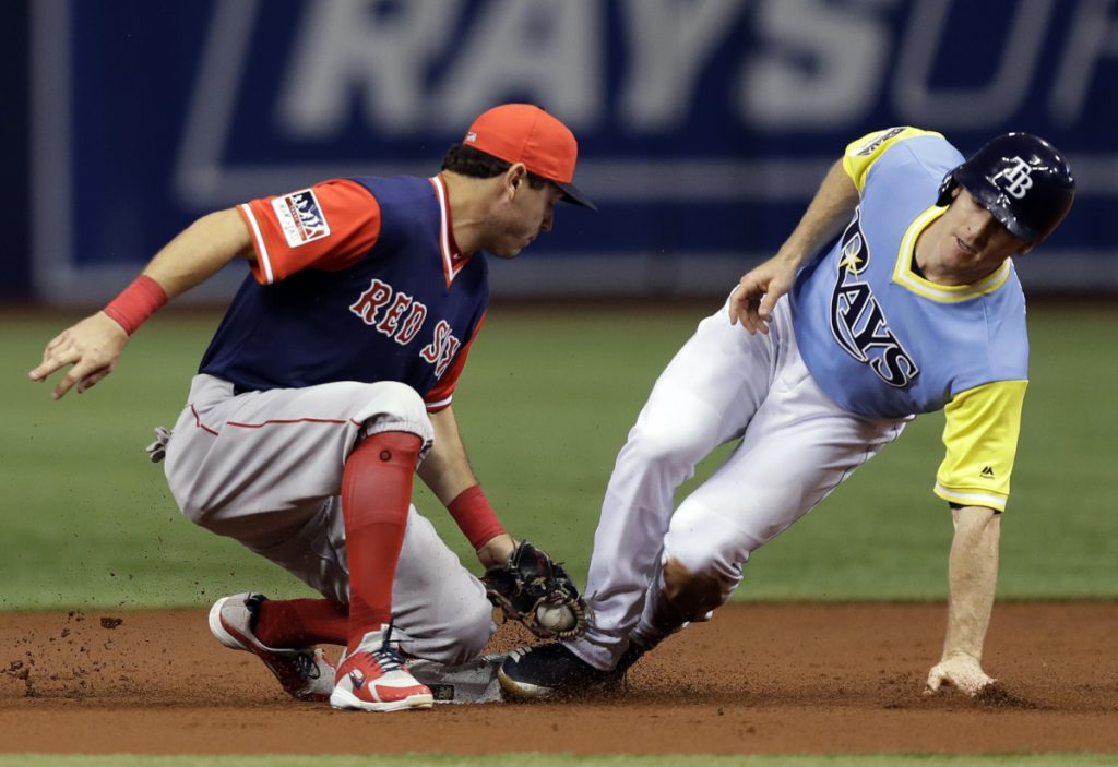 Red Sox second baseman Ian Kinsler is late with the tag as Tampa Bay's Joey Wendle steals second base Saturday night in St. Petersburg, Fla. Boston lost for the second straight night, 5-1.
