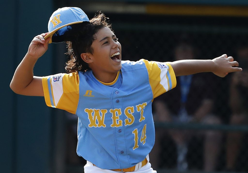 Honolulu, Hawaii pitcher Ka'olu Holt begins to celebrate after pitching a complete game, 3-0 shutout in the Little League World Series championship game Sunday against South Korea in South Williamsport, Pa.