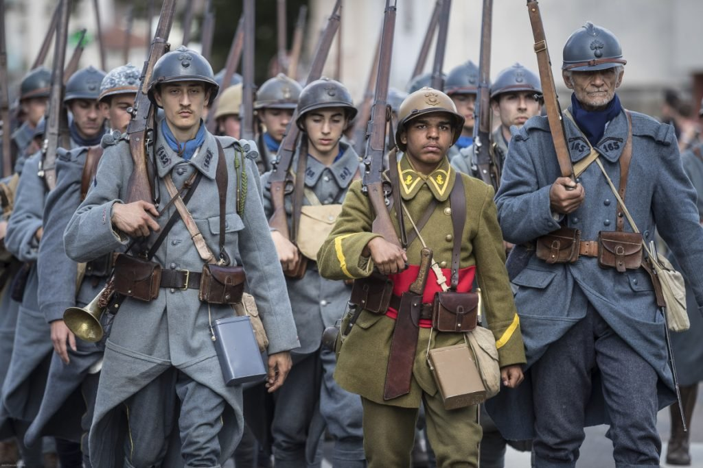 Volunteers dressed in World War I uniforms march during a parade, part of a reconstruction of the battle of Verdun, on Saturday in Verdun, eastern France.