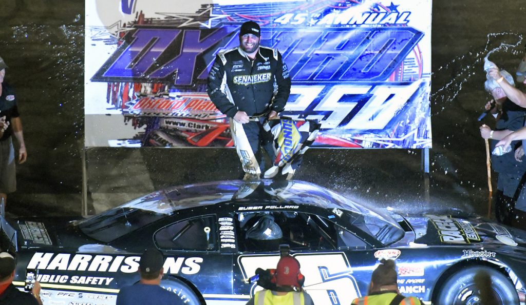 Bubba Pollard emerges from his car after winning the Oxford 25 on Sunday at Oxford Plains Speedway.