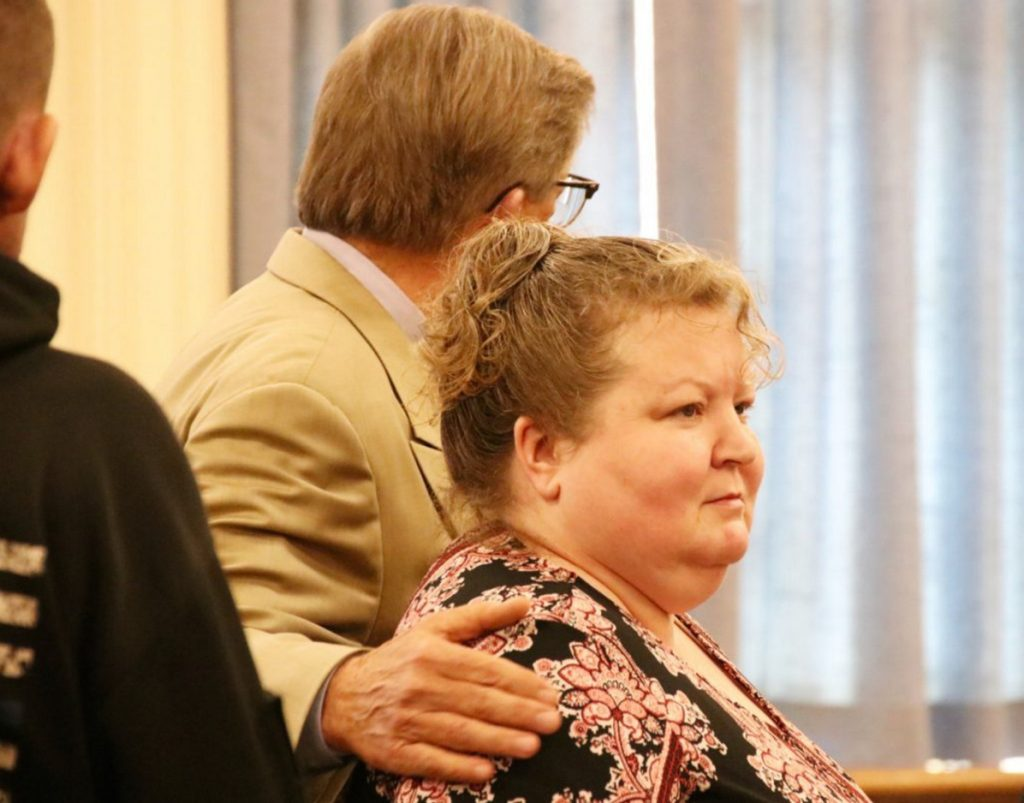 Kandee Collind of Acton, shown in court in August, wants to withdraw her guilty plea to stabbing to death her former husband, Scott Weyland, nearly two years ago. At left is her attorney, Clifford Strike.