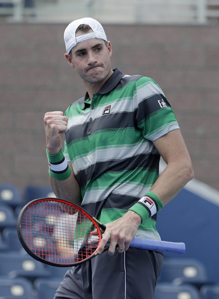 John Isner of the United States, seeded No. 11, strolled into the second round by defeating countryman Bradley Klahn in straight sets in New York.