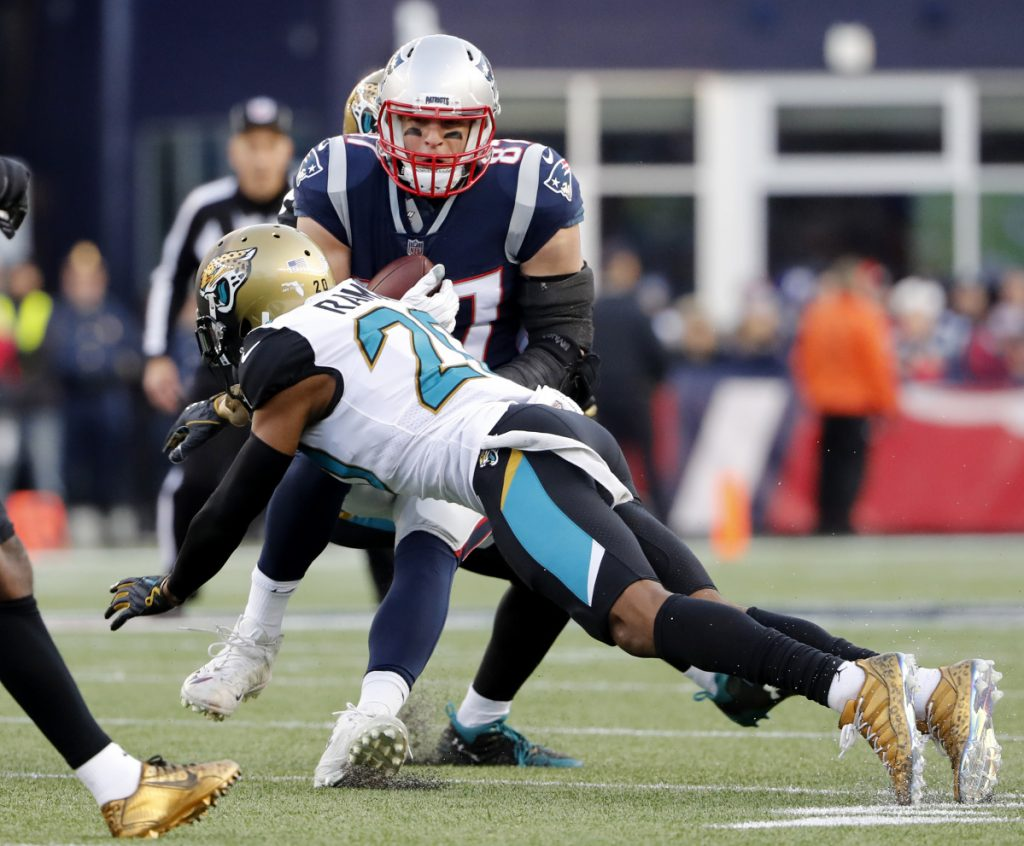 Jacksonville cornerback Jalen Ramsey dives to stop Rob Gronkowski of the New England Patriots during the AFC championship in Foxborough, Mass. in January.