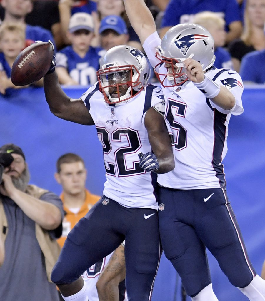 New England quarterback Danny Etling, right, and running back Ralph Webb celebrate after connecting on a touchdown pass during Thursday night's preseason finale.