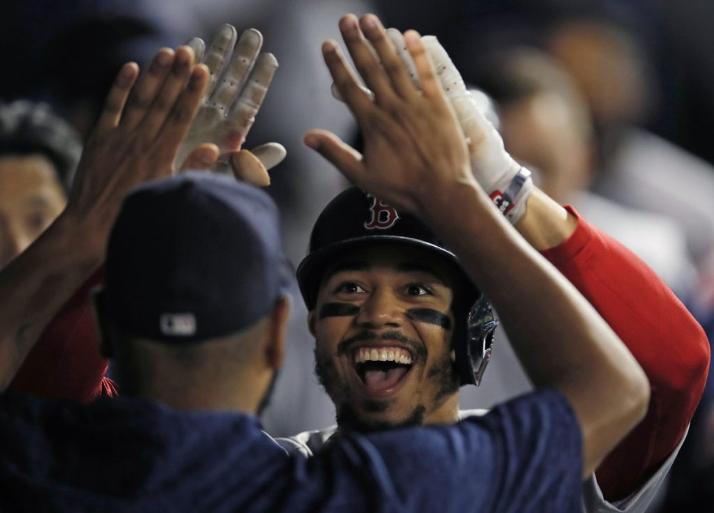 Mookie Betts celebrates after hitting a two-run home run against the Chicago White Sox in the seventh inning Thursday night in Chicago.
