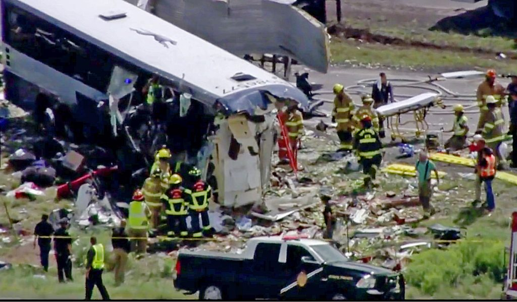First responders work at the scene of a collision between a Greyhound passenger bus and a semitruck on Interstate 40 near the town of Thoreau, N.M., on Thursday.
