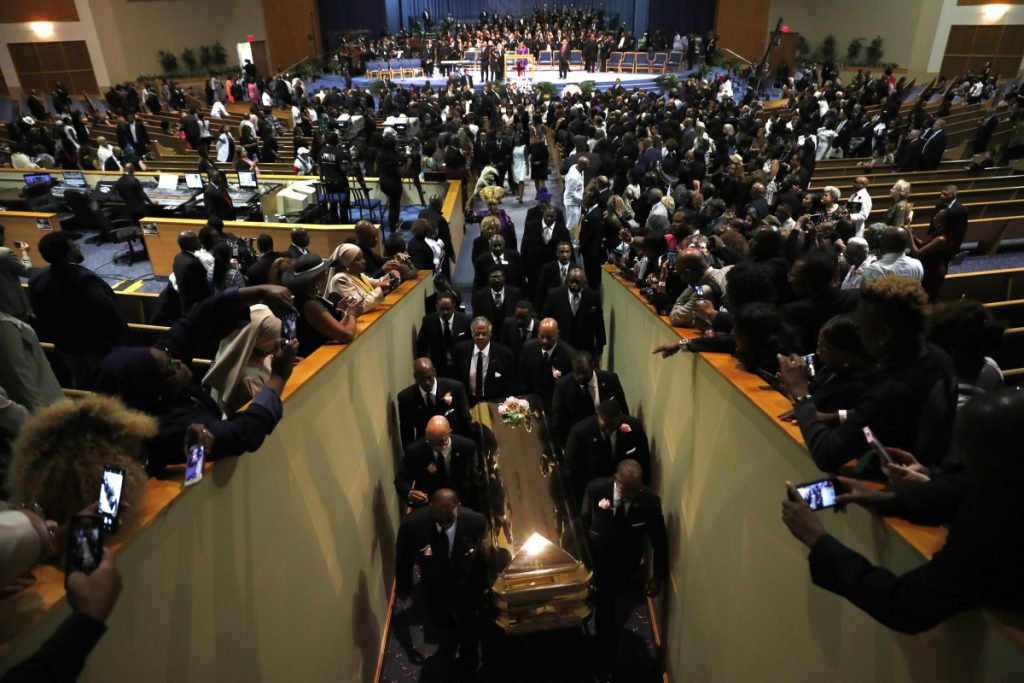 Pallbearers carry the casket out of Greater Grace Temple at the end of the funeral for Aretha Franklin on Friday in Detroit.
