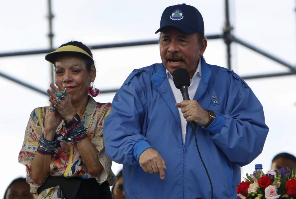 Nicaragua's President Daniel Ortega speaks to supporters as his wife and Vice President, Rosario Murillo, applauds, in Managua on Wednesday.
