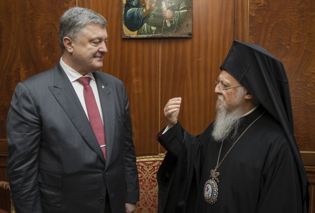 Ecumenical Patriarch Bartholomew I speaks with Ukrainian President Petro Poroshenko in Istanbul on April 9. Kiev and Moscow are wrestling over the religious fate of Ukraine.