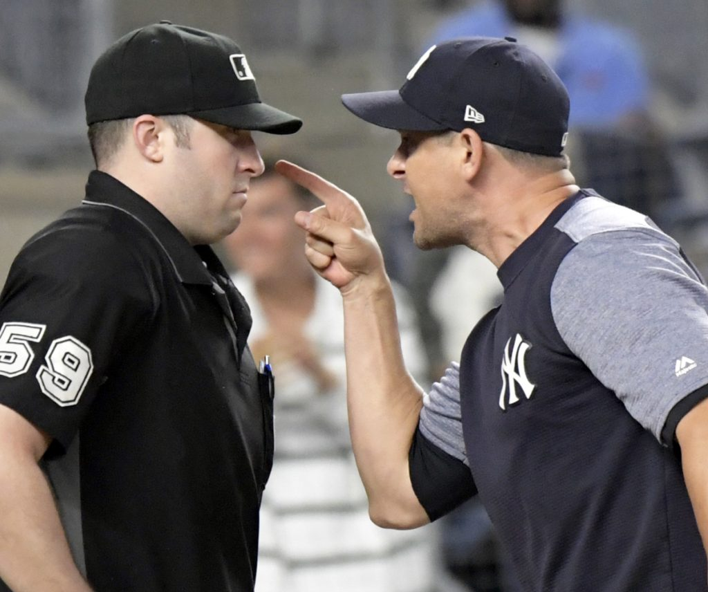 Yankees Manager Aaron Boone gets ejected in Friday night's game arguing balls and strikes with umpire Nic Lentz in the fifth inning. During his argument, Boone crouched down impersonating a catcher behind the plate.