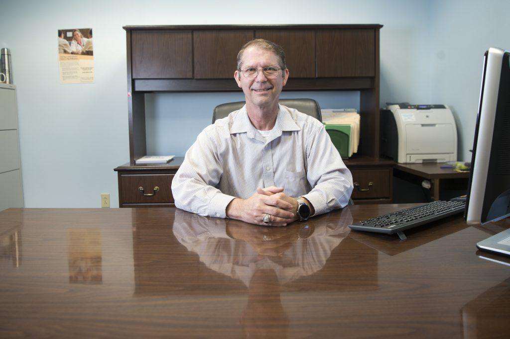 China Town Manager Dennis Heath sits at his desk Thursday at the China Town Office.