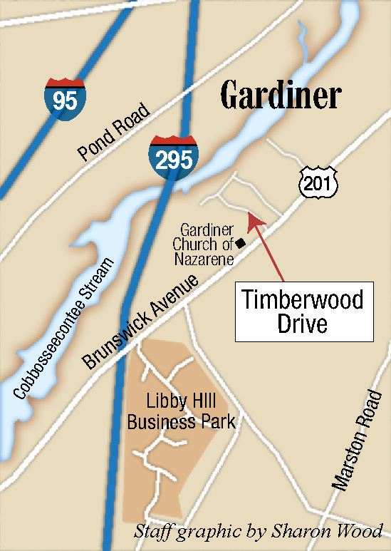 The intersection of Timberwood Drive and U.S. Route 201 in Gardiner, seen Friday, is near where Sturbridge, Massachusetts, resident Gyrth Rutan was pulled over for a traffic stop, he shot himself to death, and police discovered a woman's body in the trunk of the car he was driving.