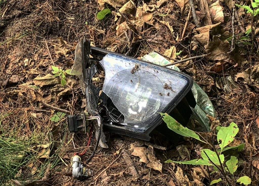 A broken headlight remains on the side of the road Sunday afternoon at the scene of a fatal crash early that morning on Augusta Road in Winslow. Gabe Stuart, 52, of Waterville, was pronounced dead at the scene by medical personnel. Police have yet to determine the accident's cause.