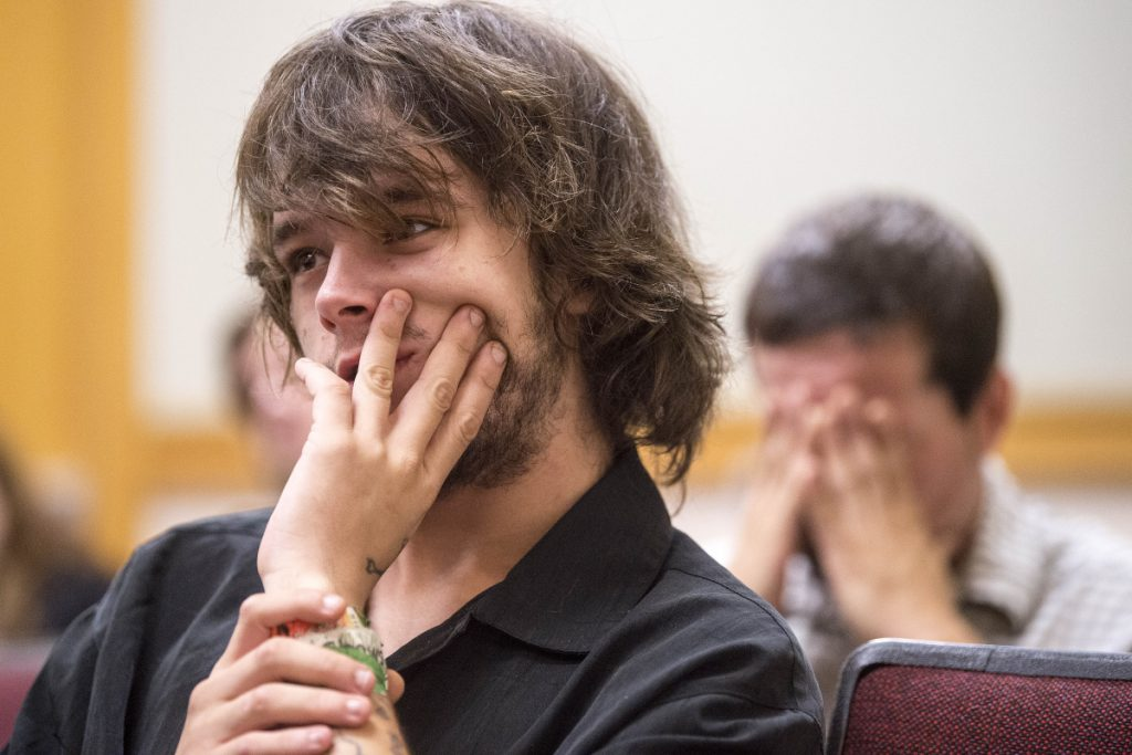 Paul Goodridge, back right, sits in court with his son Noah Goodridge, who waits to enter a not guilty plea Wednesday in Skowhegan District Court to a charge of assault in connection with a June 12 incident involving a Skowhegan police officer. Goodridge says he had a seizure and the police officer, who arrested him, misunderstood what was happening.