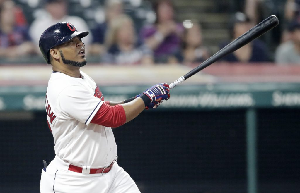Cleveland's Edwin Encarnacion follows through on a three-run home run during the Indians' 10-0 win over teh Twins on Monday in Cleveland.
