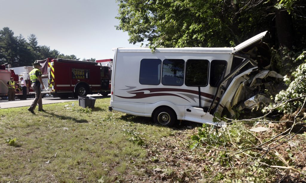 New Hampshire State Police investigate the crash on Interstate 95 in Greenland, N.H., on Aug. 10. The bus was carrying 11 children participating in a Kittery recreation program.