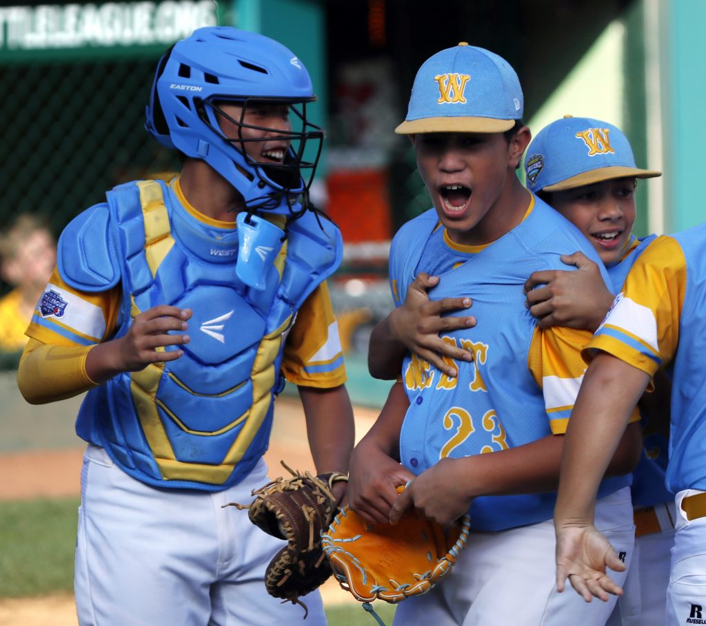 Honolulu, Hawaii's Aukai Kea (23) celebrates with catcher Bruce Boucher, left, and Taylin Oana after getting the final out of the United States Championship game against Peachtree City, Ga. on Saturday at the Little League World Series tournament in South Williamsport, Pa.
