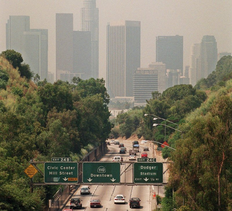 In this July 1998 file photo, traffic drives toward downtown Los Angeles on the 110 freeway as a curtain of smog shrouds the skyline.
