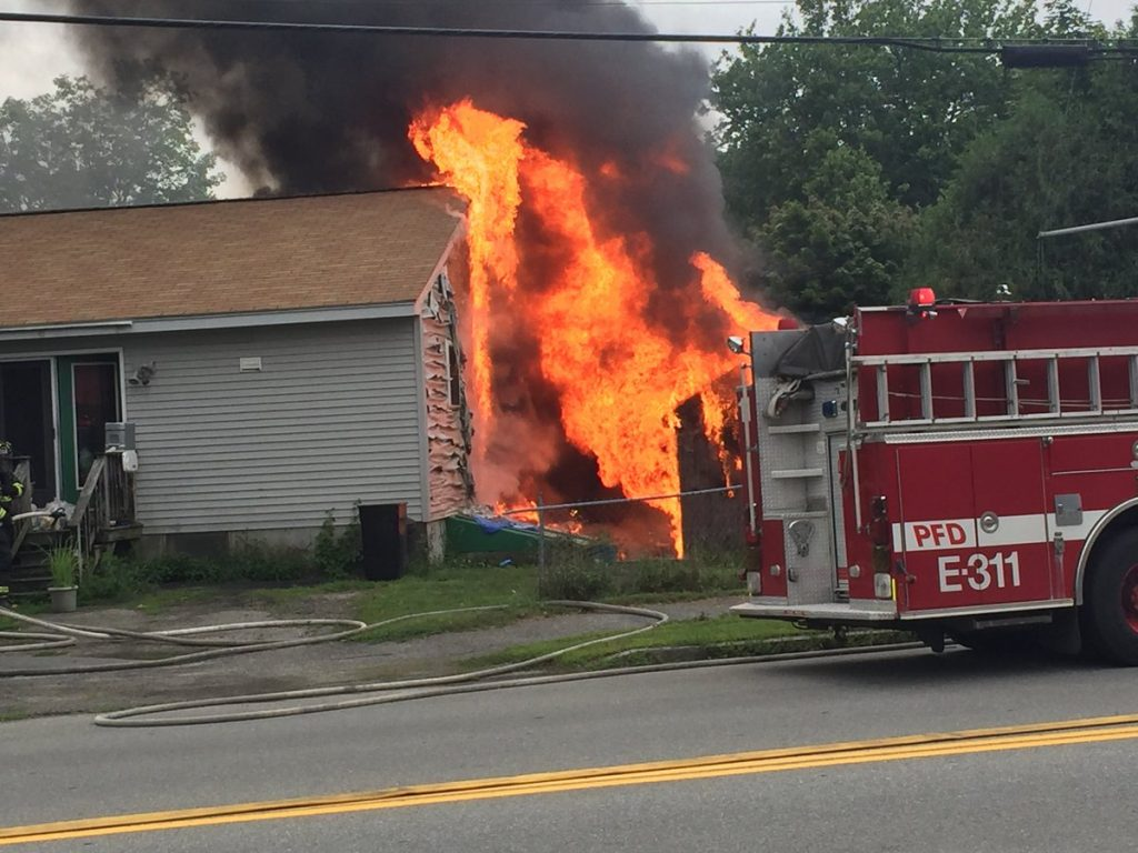 A fire that started in a shed engulfs a house on Berkshire Road in Portland.