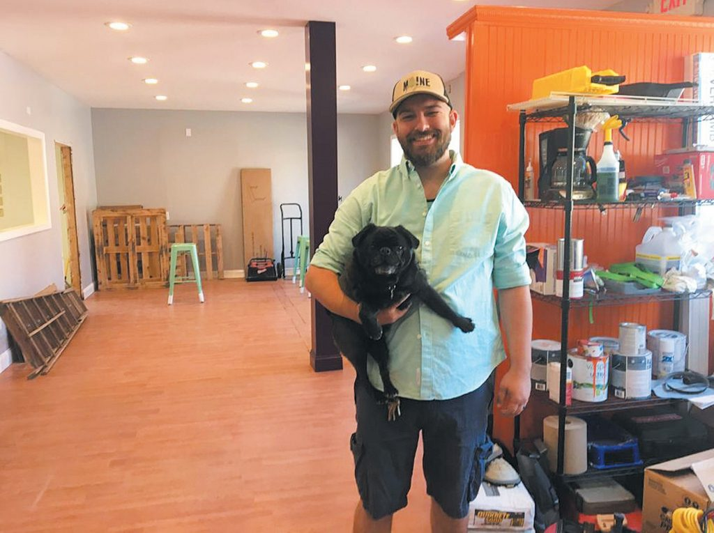 Sam Wilson and his dog Gir at Black Pug Brewing at 30 Bath Road. Wilson and a business partner hope to have the brewery open by October.