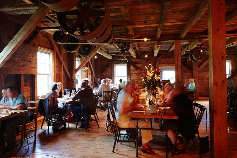 Communal tables enhance the convivial, dinner-party atmosphere of The Lost Kitchen restaurant in Freedom.