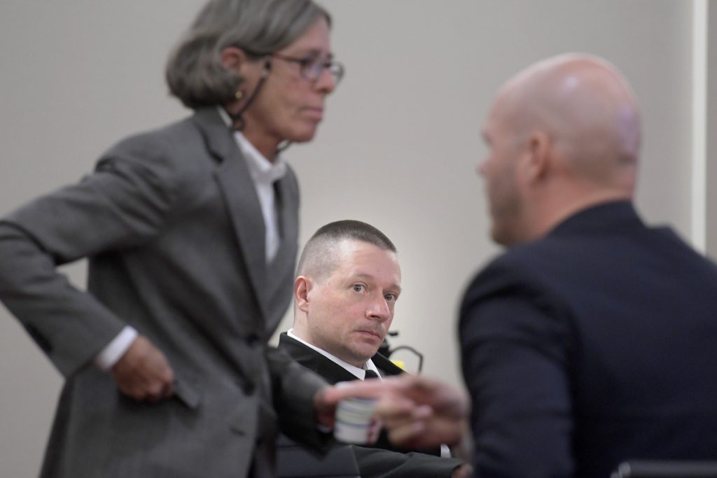 Scott Bubar, center, observes his attorneys, Lisa Whittier and Scott Hess, as they prepare for opening remarks Monday at his trial in Augusta.