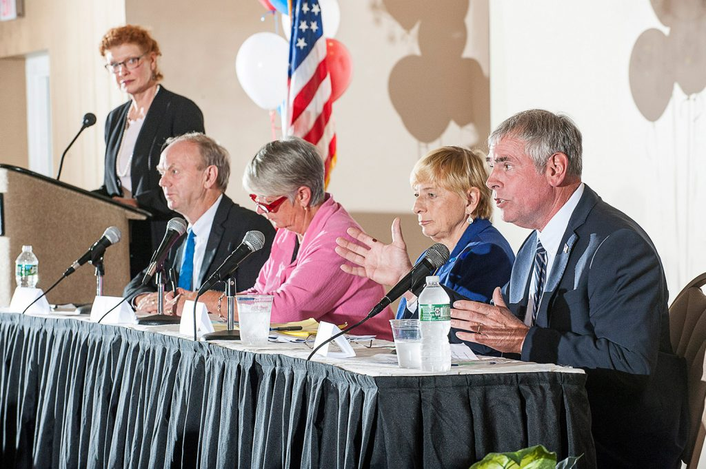 Maine's candidates for governor, seated from left, Alan Caron, Terry Hayes, Janet Mills and Shawn Moody, met Sept. 10 in Lewiston for a candidate forum hosted by the Auburn Metropolitan Chamber of Commerce.  Next week the debate season will get underway in earnest.