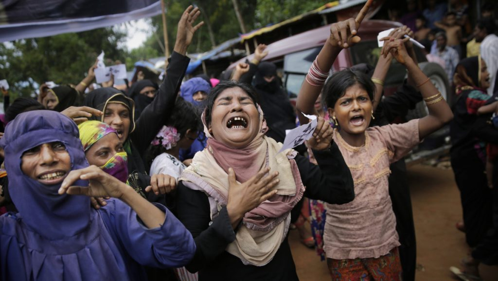 """Rohingya women cry during an Aug. 25 rally at a Bangladesh refugee camp, marking the first anniversary of the Myanmar army's crackdown. The U.N. estimates the toll at a """"conservative"""" figure of 10,000 killed."""