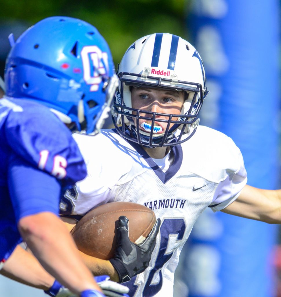 Yarmouth running back Camden Miller looks for room to run against Oak Hill High on Saturday in Wales.