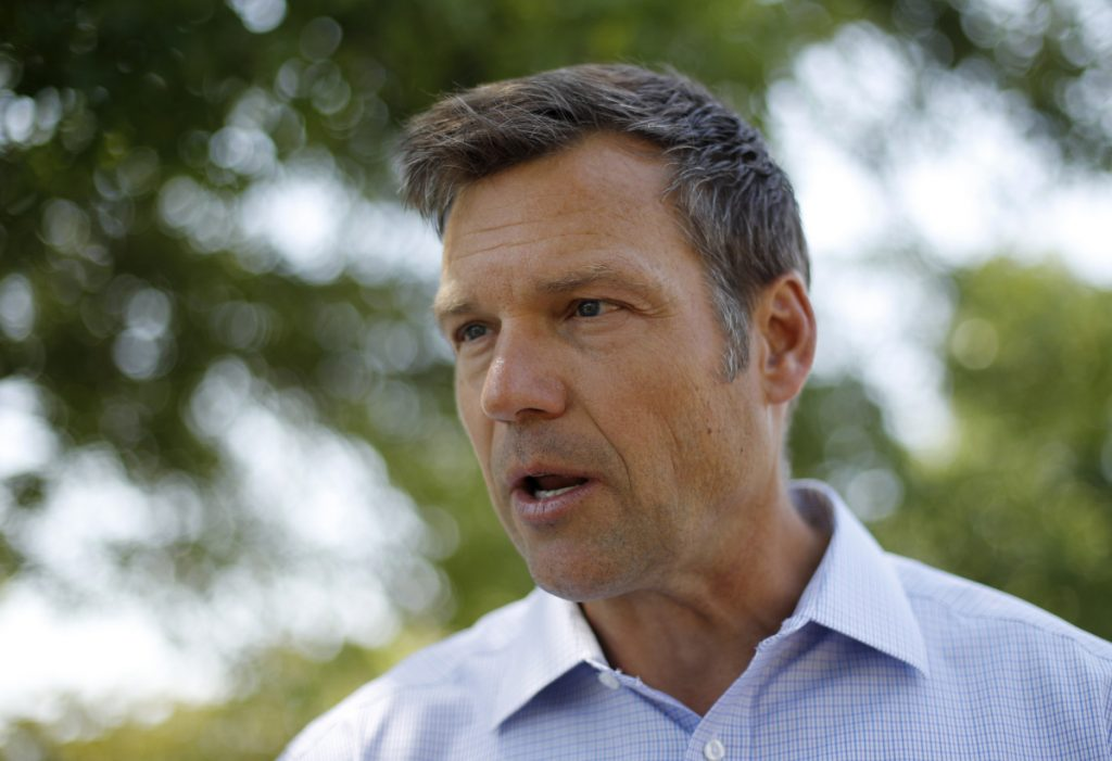 Kris Kobach, Kansas secretary of state and candidate for the Republican nomination for Kansas governor,  addresses supporters in early August.