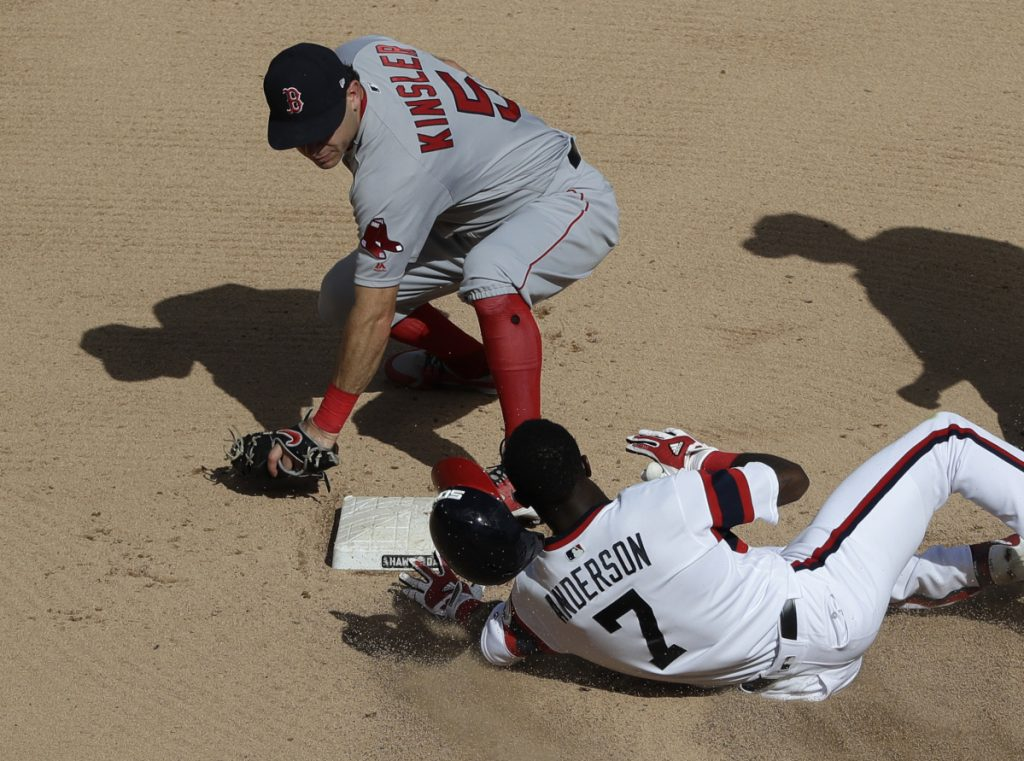 Chicago White Sox's Tim Anderson (7) slides safely into second base after hitting a double as Boston Red Sox second baseman Ian Kinsler applies a late tag during the sixth inning of a baseball game Sunday, Sept. 2, 2018, in Chicago. (AP Photo/Nam Y. Huh)