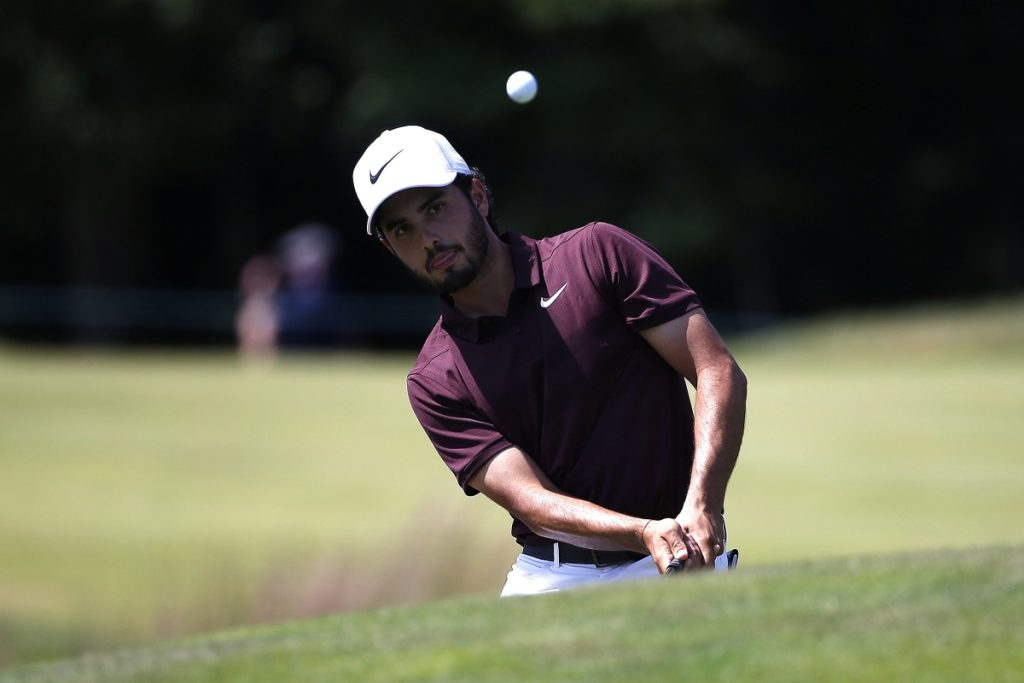 Abraham Ancer chips onto the second green Sunday during the third round of the Dell Technologies Championship in Norton, Mass., Sunday, Sept. 2, 2018. Ancer shot a 6-under 65 to move to the top of a crowded leaderboard.