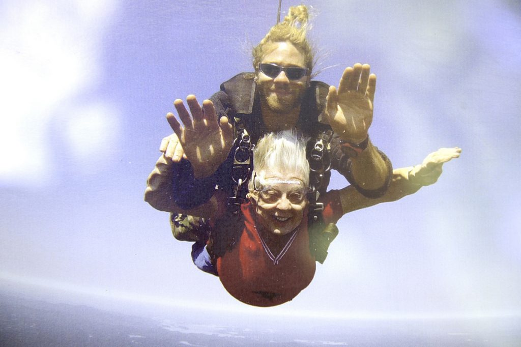 """""""I was smiling all the way down,"""" Georgieanna McArthur said of her first time skydiving. McArthur jumped out of an airplane for her second time on Aug. 10 at the age of 79."""
