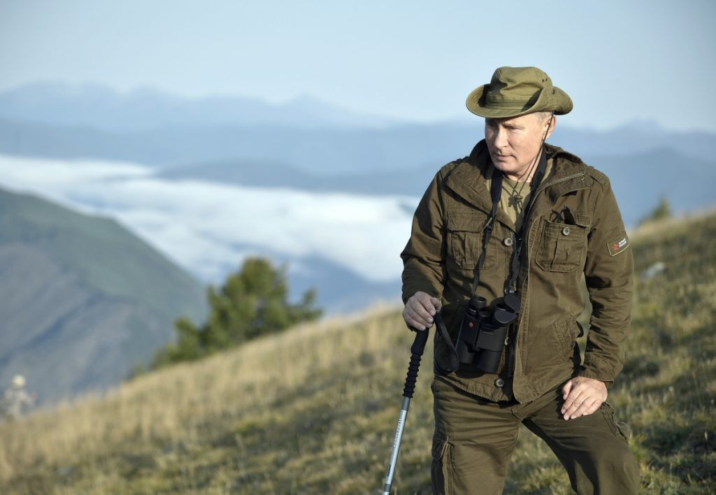 Russian President Vladimir Putin rests during a mini-break in the Siberian Tyva region. A state-owned TV channel has a new weekly current affairs program devoted to Putin.