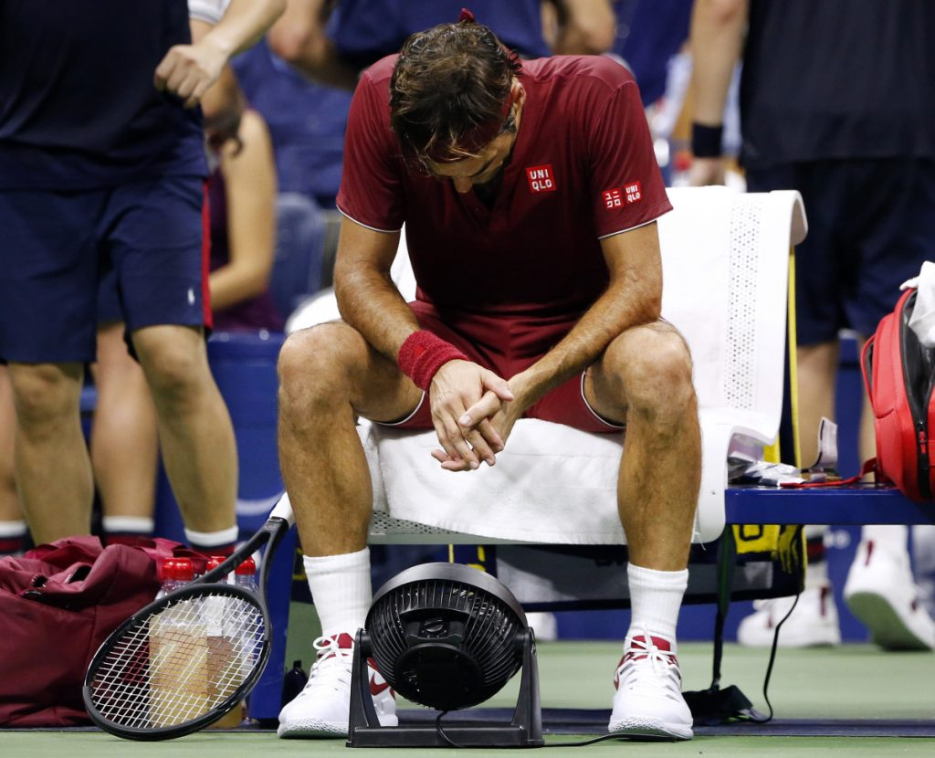 Roger Federer, of Switzerland, sits in front of a fan during a changeover in his match against John Millman, of Australia, during the fourth round of the U.S. Open tennis tournament early Tuesday, Sept. 4, 2018, in New York. (AP Photo/Jason DeCrow) Roger Federer sits in front of a fan during a changeover in his match against John Millman at the U.S. Open early Tuesday. (AP Photo/Jason DeCrow)