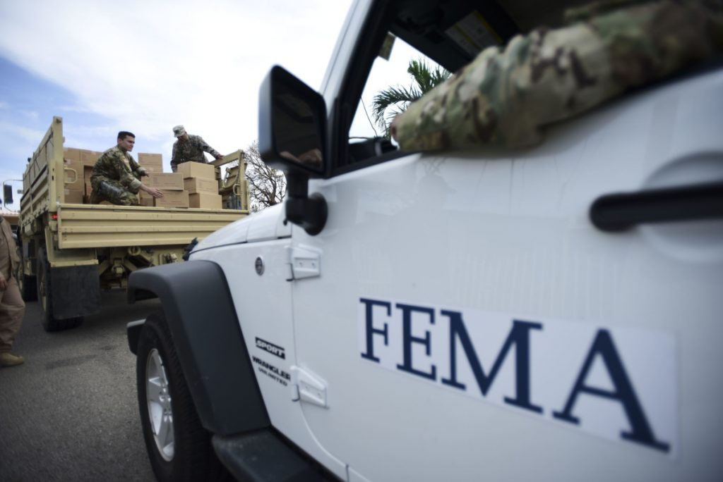 Department of Homeland Security personnel distribute supplies in Puerto Rico in October 2017. A report by the Government Accountability Office says that FEMA personnel were not prepared to deal with the aftermath of Hurricane Maria.