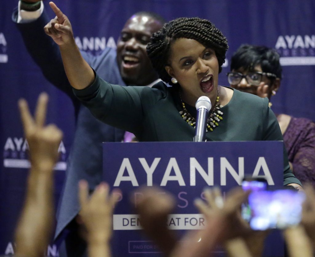 "Boston City Councilor Ayanna Pressley celebrates her victory Tuesday over U.S. Rep. Michael Capuano. ""With our rights under assault, with our freedoms under siege, it isn't good enough to see Democrats back in power, but it matters who those Democrats are,"" Pressley said."