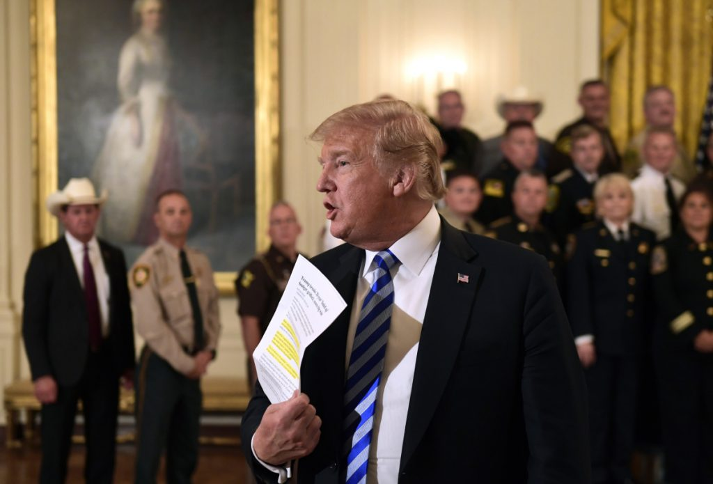 "President Trump responds to a reporter's question Wednesday during an event at the White House. Responding to the critical New York Times opinion piece by an anonymous administration official, Trump said, ""They don't like Donald Trump and I don't like them."""