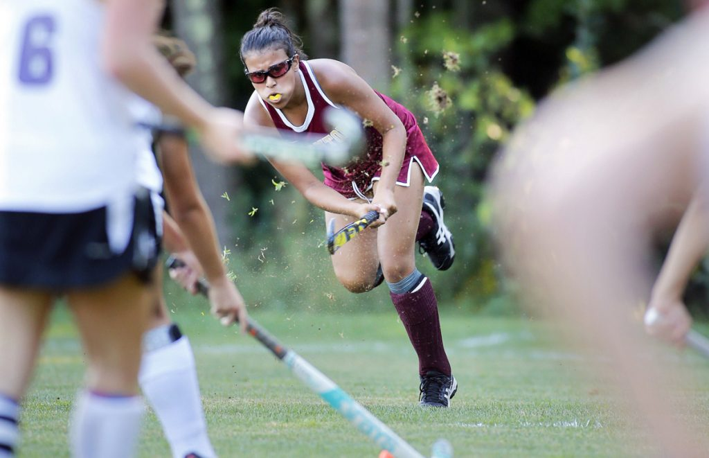 Thornton Academy's Aliyah Bureau sends the ball forward during a Class A South field hockey match Wednesday against Marshwood. Bureau assisted on the first goal for the Trojans in a 2-0 victory.