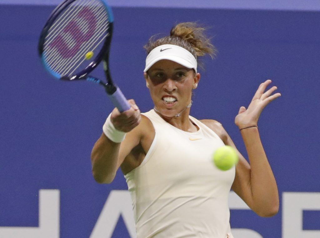 Madison Keys beat Carla Suarez Navarro in straight sets on Wednesday night to advance to the semifinals of the U.S. Open in New York. The 14th-seeded Keys, a finalist a year ago, faces No. 20 Naomi Osaka in the semifinals.