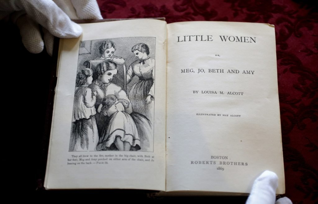 "An illustration and title page to the book ""Little Women"" by Louisa May Alcott appear in an 1869 edition of the book at Orchard House in Concord, Mass. A movie based on the novel will be filmed this fall."