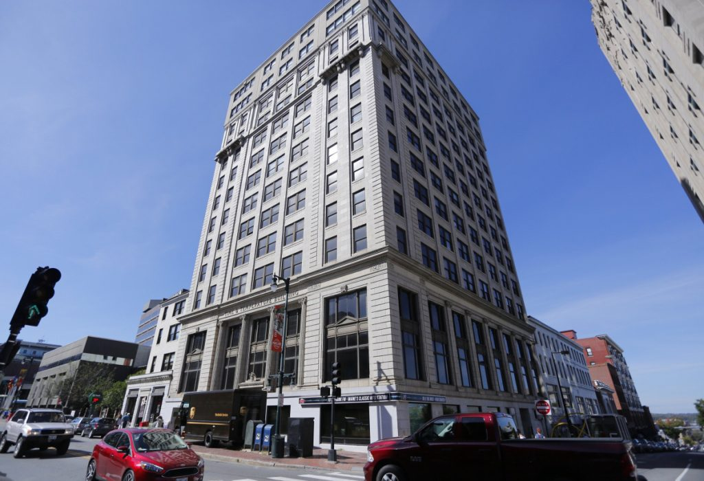 The 14-story Time & Temperature Building at 477 Congress St. – which opened in 1924 as the 12-story Chapman Building – was seized by a collections agency in 2016 after years of neglect and a mass exodus of tenants. The property comes with a 340-space parking garage.