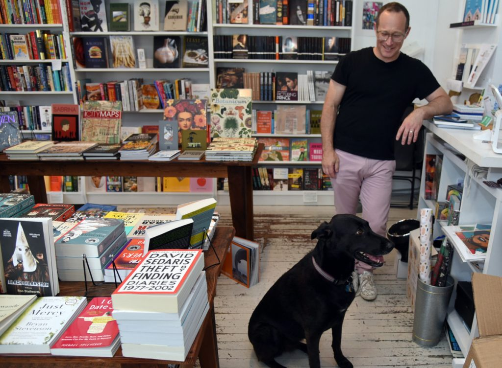 One way that Greedy Reads in Fells Point, Md., makes the buying experience personal is by allowing bookstore customers like Dr. John Krakauer to bring their leashed dogs.