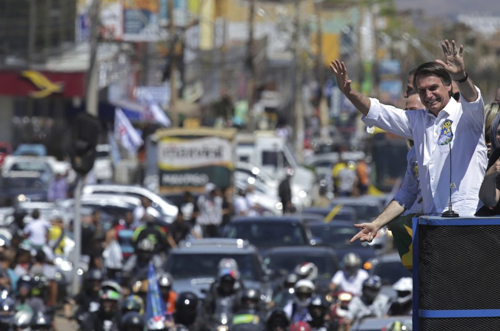 National Social Liberal Party presidential candidate Jair Bolsonaro greets supporters as he campaigns in Brasilia's Ceilandia neighborhood, on Wednesday.