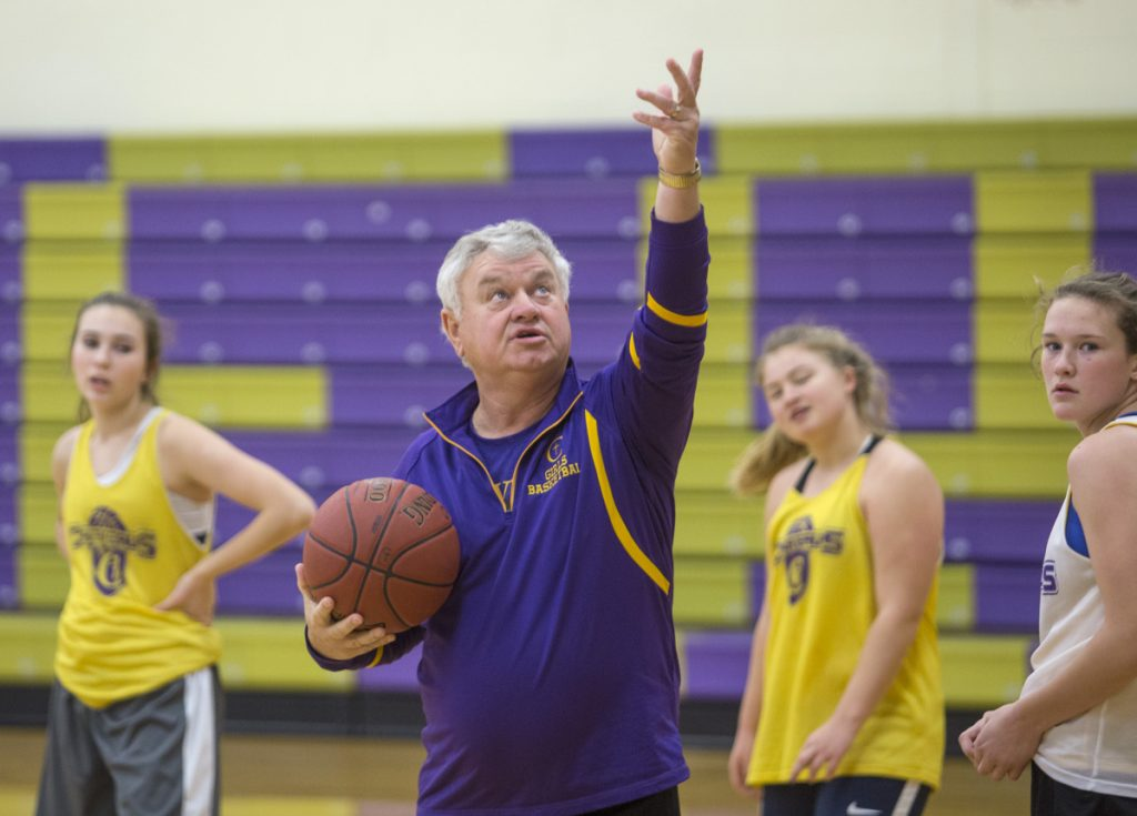 Gary Fifield works with players last November during a preseason girls' basketball practice at Cheverus High. (Photo by Derek Davis/Staff photographer)