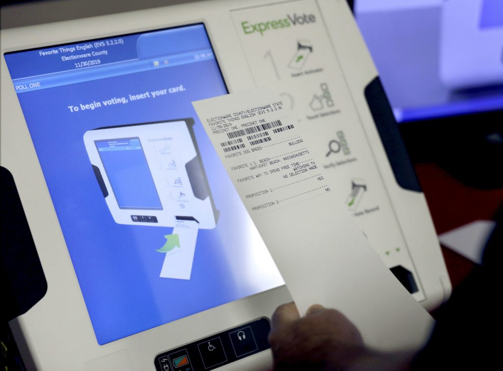 A new voting machine prints a paper record at a polling site in Georgia last year. A report from the National Academy of Sciences calls for more-secure voting systems that use paper ballots or equivalents.
