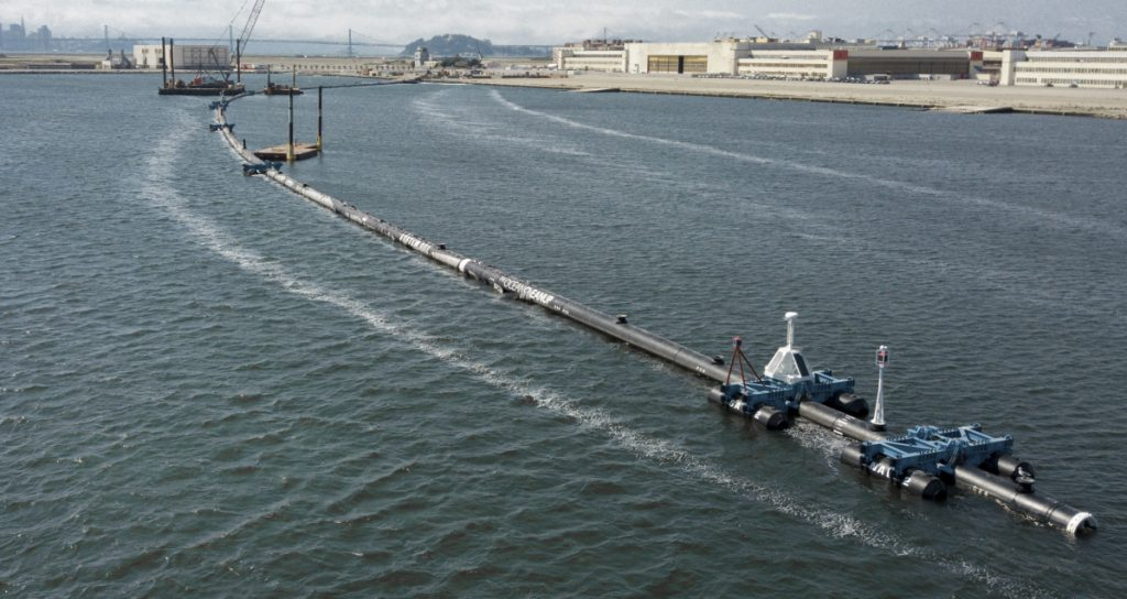 A long floating boom that will be used to corral plastic litter in the Pacific Ocean is assembled in Alameda, Calif. Engineers will deploy the device between California and Hawaii in an attempt to trap some of the 1.8 trillion pieces of plastic from The Great Pacific Garbage Patch.